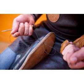 Reparação e arranjos de calçado